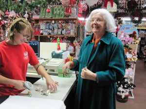 Mom making her purchases at The Christmas Mouse
